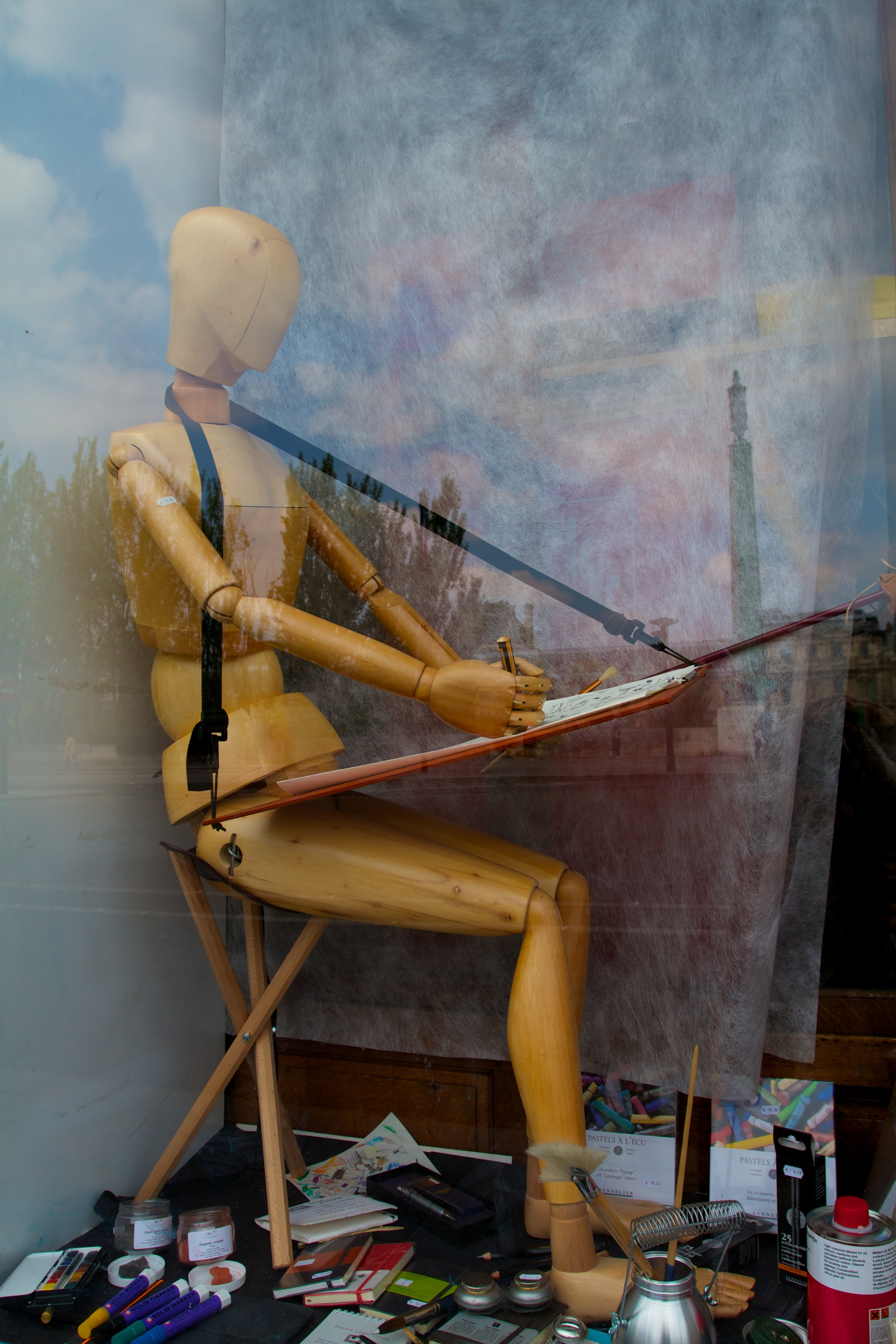 wooden artists mannequin in a shop window